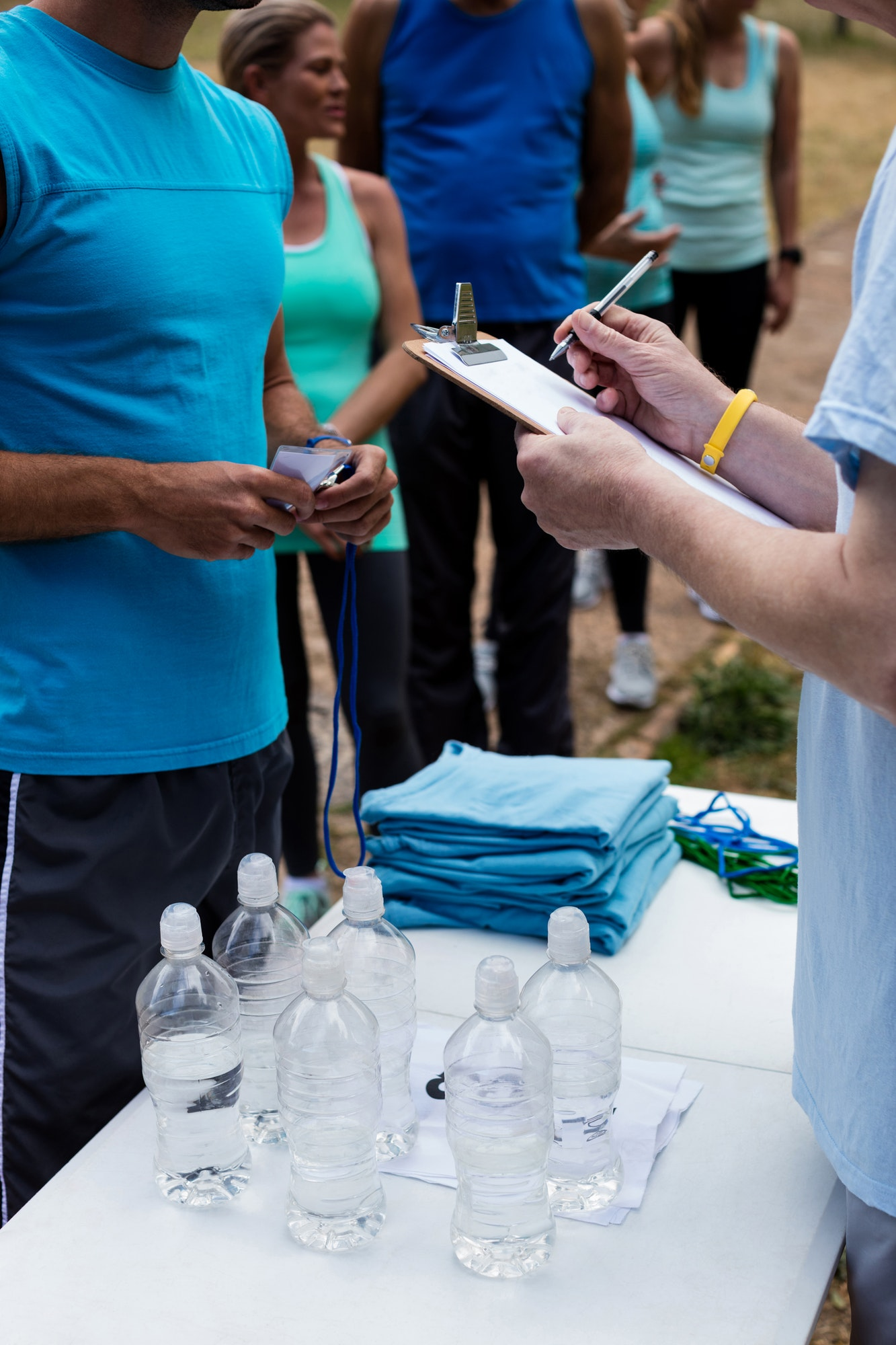 Volunteer registering athletes name for race